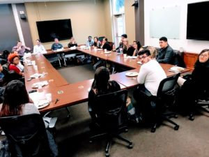 First Generation Students Sitting Around Conference Table